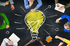 People gathered around an idea lightbulb