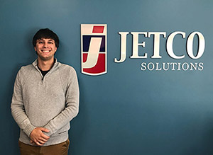 Paul Costopulos next to the JetCo Solutions sign