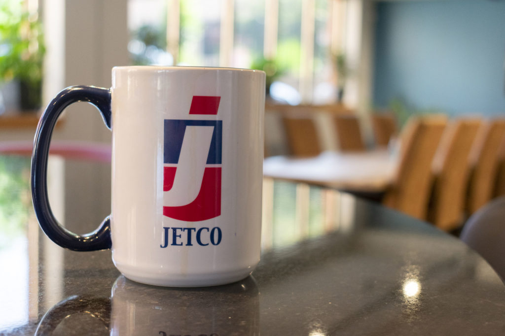 JetCo Solutions mug with office in the background